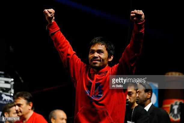 Manny Pacquiao gestures to the crowd during his official weighin on May 1 2015 at MGM Grand Garden Arena in Las Vegas Nevada Pacquiao will face Floyd...