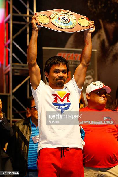 Manny Pacquiao holds up the WBO belt during his official weighin on May 1 2015 at MGM Grand Garden Arena in Las Vegas Nevada Pacquiao will face Floyd...