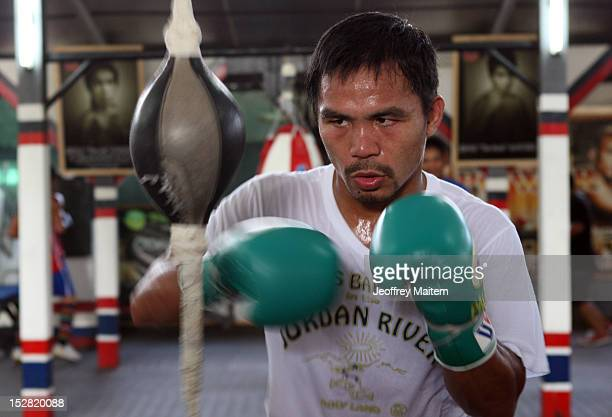 Manny Pacquiao in action during a training session at Golingan Gymnasium on September 27 2012 in General Santos Philippines Pacquiao will take on...