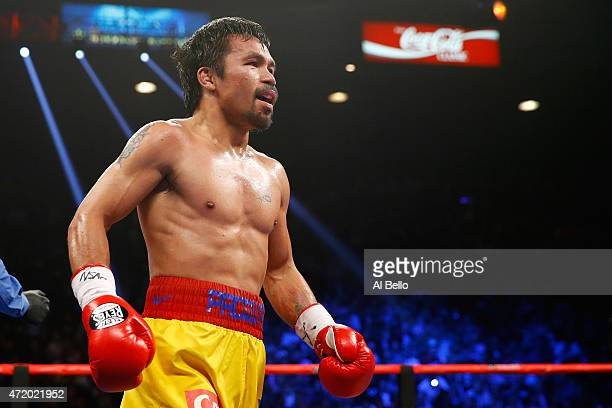 Manny Pacquiao in the ring between rounds during the welterweight unification championship bout on May 2 2015 at MGM Grand Garden Arena in Las Vegas...