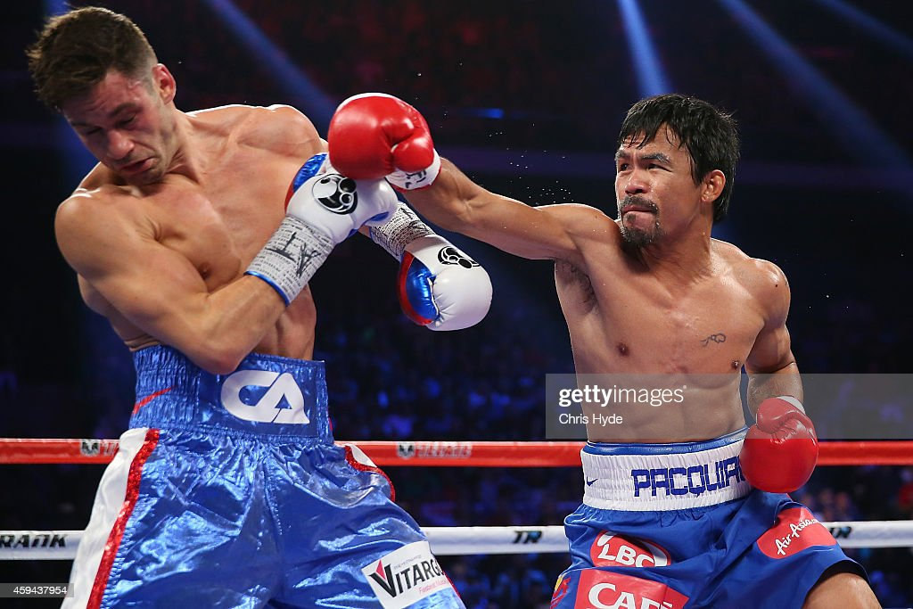 <a gi-track='captionPersonalityLinkClicked' href=/galleries/search?phrase=Manny+Pacquiao&family=editorial&specificpeople=3855506 ng-click='$event.stopPropagation()'>Manny Pacquiao</a> of the Philippines and <a gi-track='captionPersonalityLinkClicked' href=/galleries/search?phrase=Chris+Algieri&family=editorial&specificpeople=12683034 ng-click='$event.stopPropagation()'>Chris Algieri</a> of the United States exchange punches during the WBO world welterweight title at The Venetian on November 23, 2014 in Macau, Macau.
