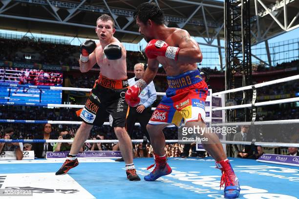 Manny Pacquiao of the Philippines and Jeff Horn of Australia exchange punches during the WBO World Welterweight Title Fight at Suncorp Stadium on...