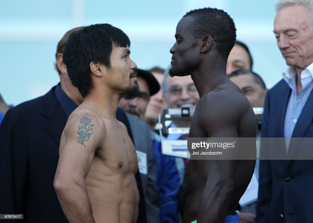 Manny Pacquiao of the Philippines and Joshua Clottey of Ghana pose after the weighin for their WBO welterweight title fight outside Cowboys Stadium...