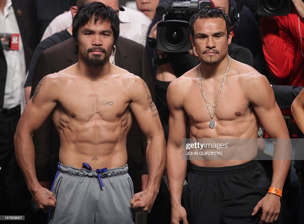 Manny Pacquiao (L) of the Philippines and Juan Manuel Marquez (R) of Mexico pose during their weigh-in December 7, 2012 in Las Vegas, Nevada. Filipino southpaw Pacquiao needs a statement victory over Marquez in the fourth installment of their epic rivalry December 8, 2012 to prove once and for all who is the better fighter. AFP PHOTO / John GURZINSKI