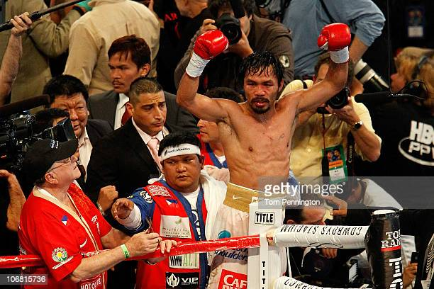Manny Pacquiao of the Philippines celebrates after he was declared the winner by a unanimous decision against Antonio Margarito of Mexico during...