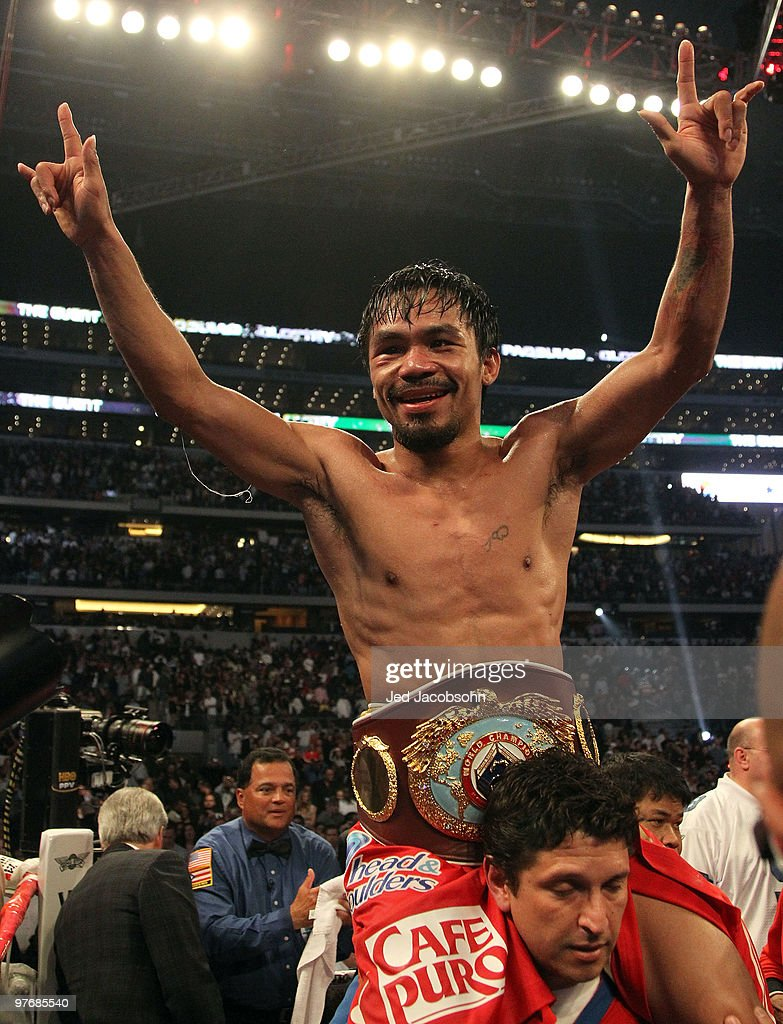 <a gi-track='captionPersonalityLinkClicked' href=/galleries/search?phrase=Manny+Pacquiao&family=editorial&specificpeople=3855506 ng-click='$event.stopPropagation()'>Manny Pacquiao</a> of the Philippines celebrates in the ring after defeating Joshua Clottey of Ghana during the WBO welterweight title fight at Cowboys Stadium on March 13, 2010 in Arlington, Texas. Pacquiao defeated Clottey by unanimous decision.