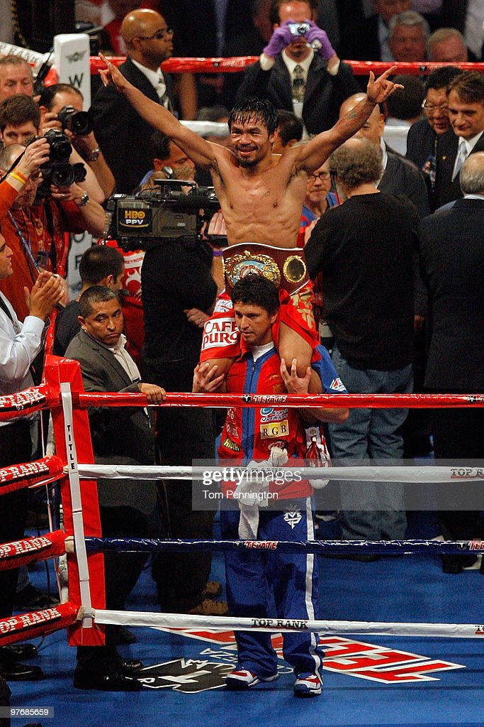 Manny Pacquiao of the Philippines celebrates in the ring after defeating Joshua Clottey of Ghana during the WBO welterweight title fight at Cowboys...