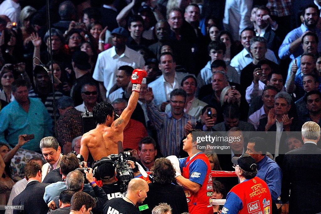 Manny Pacquiao of the Philippines celebrates in the ring after defeating Joshua Clottey of Ghana during the WBO welterweight title fight at Cowboys Stadium on March 13, 2010 in Arlington, Texas. Pacquiao defeated Clottey by unanimous decision.