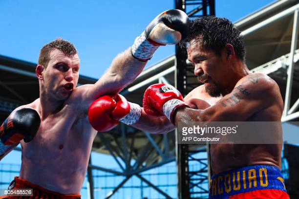CORRECTION Manny Pacquiao of the Philippines fight Jeff Horn of Australia during the World Boxing Organization boat at Suncorp Stadium in Brisbane on...