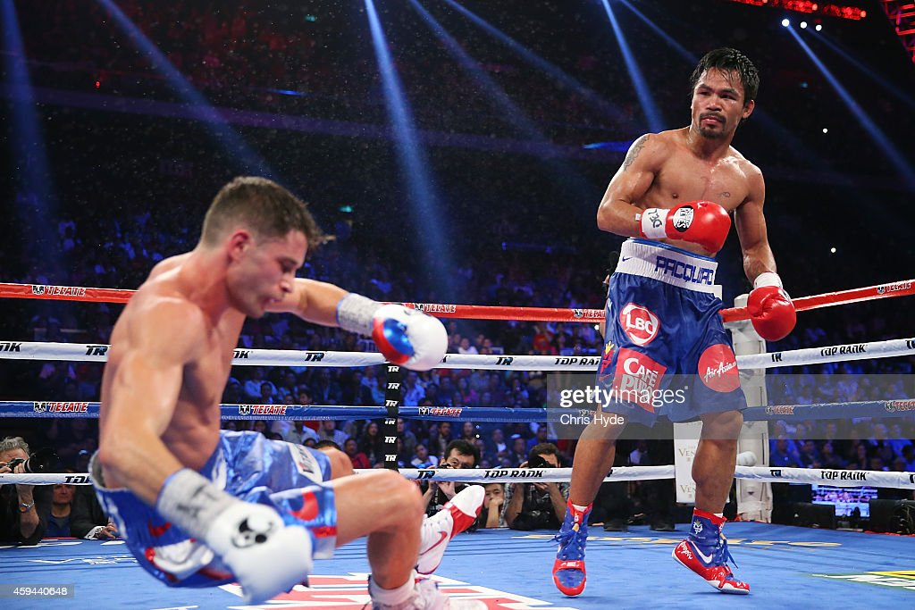 <a gi-track='captionPersonalityLinkClicked' href=/galleries/search?phrase=Manny+Pacquiao&family=editorial&specificpeople=3855506 ng-click='$event.stopPropagation()'>Manny Pacquiao</a> of the Philippines knockes down <a gi-track='captionPersonalityLinkClicked' href=/galleries/search?phrase=Chris+Algieri&family=editorial&specificpeople=12683034 ng-click='$event.stopPropagation()'>Chris Algieri</a> of the United States during the world welterweight title at The Venetian on November 23, 2014 in Macau, Macau.