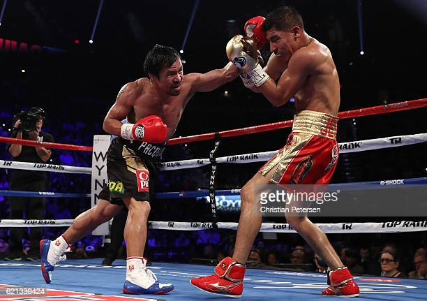 Manny Pacquiao of the Philippines lands a left to the head of Jessie Vargas during their WBO welterweight championship fight at the Thomas Mack...