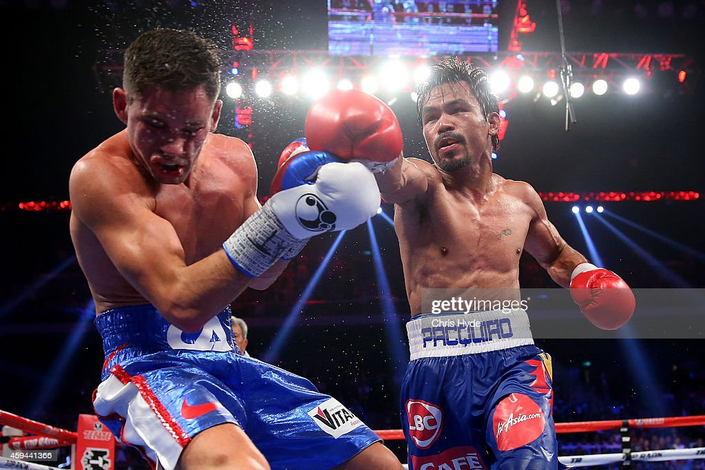 <a gi-track='captionPersonalityLinkClicked' href=/galleries/search?phrase=Manny+Pacquiao&family=editorial&specificpeople=3855506 ng-click='$event.stopPropagation()'>Manny Pacquiao</a> of the Philippines punches <a gi-track='captionPersonalityLinkClicked' href=/galleries/search?phrase=Chris+Algieri&family=editorial&specificpeople=12683034 ng-click='$event.stopPropagation()'>Chris Algieri</a> of the United States during the WBO world welterweight title at The Venetian on November 23, 2014 in Macau, Macau.