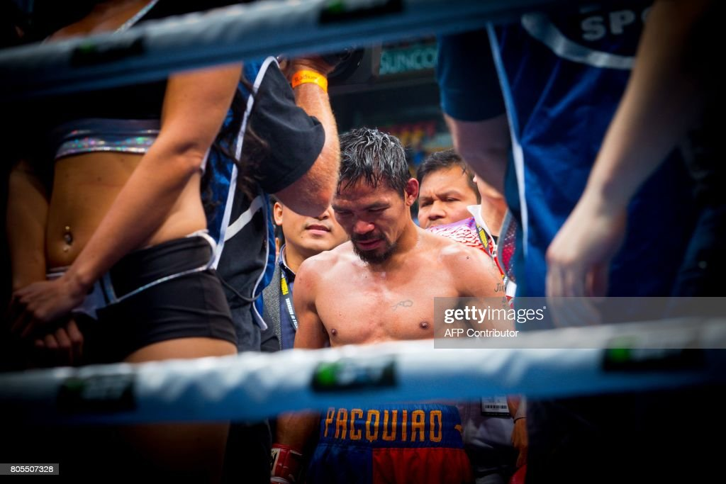 TOPSHOT - Manny Pacquiao of the Philippines reacts to fans following his defeat to Jeff Horn of Australia in their World Boxing Organisation welterweight boxing match at Suncorp Stadium in Brisbane on July 2, 2017. Former schoolteacher Jeff Horn stunned world champion Manny Pacquiao to win the World Boxing Organisation welterweight crown with a unanimous points decision in Brisbane on July 2. / AFP PHOTO / Patrick HAMILTON / -- IMAGE