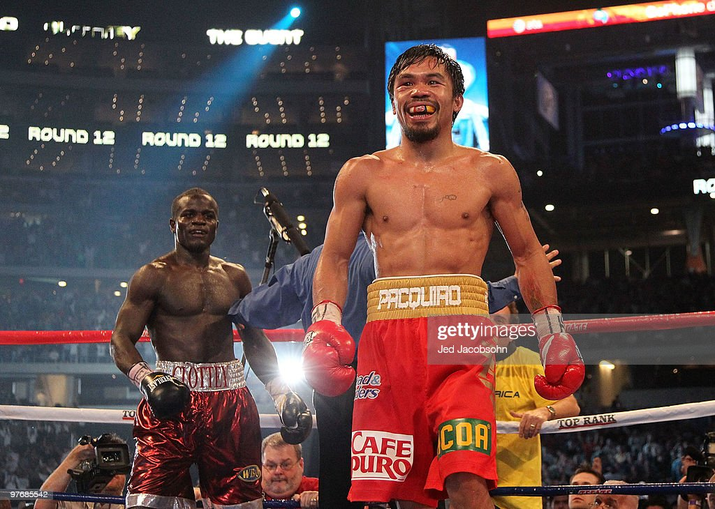 Manny Pacquiao of the Philippines smiles in the ring after the final bell against Joshua Clottey of Ghana during the WBO welterweight title fight at Cowboys Stadium on March 13, 2010 in Arlington, Texas. Pacquiao defeated Clottey by unanimous decision.