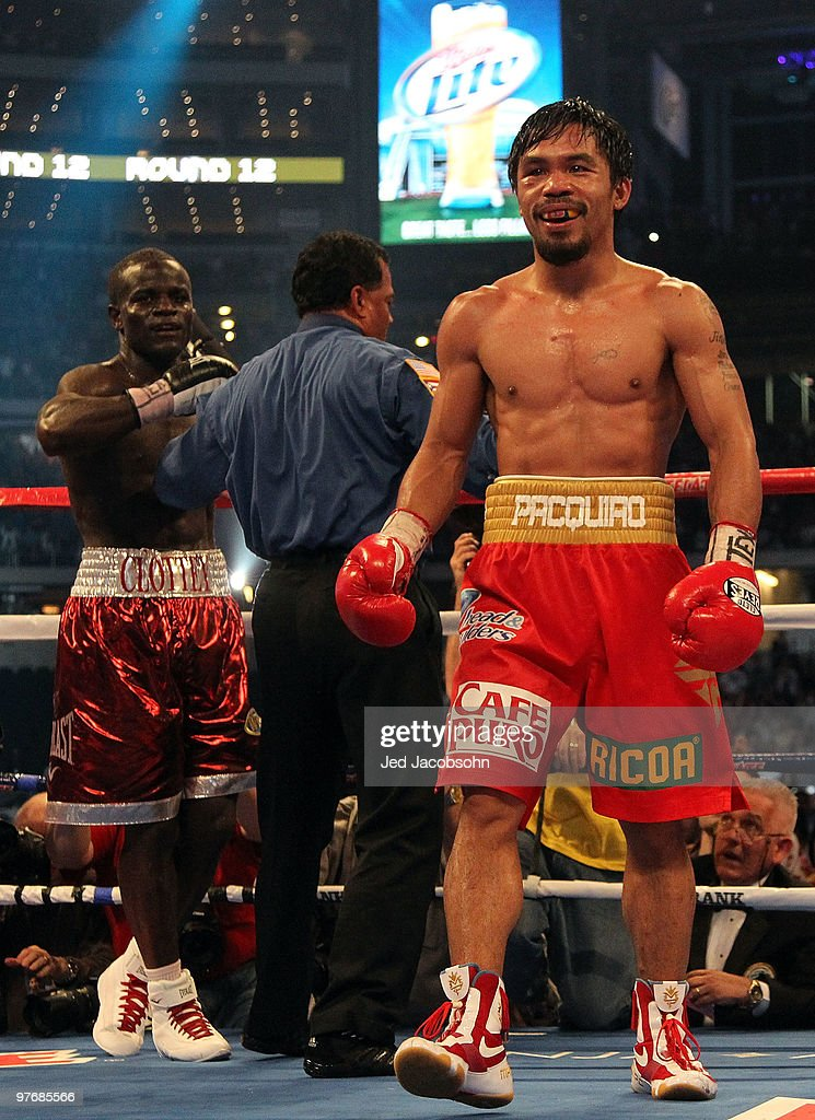 <a gi-track='captionPersonalityLinkClicked' href=/galleries/search?phrase=Manny+Pacquiao&family=editorial&specificpeople=3855506 ng-click='$event.stopPropagation()'>Manny Pacquiao</a> of the Philippines smiles in the ring after the final bell against Joshua Clottey of Ghana during the WBO welterweight title fight at Cowboys Stadium on March 13, 2010 in Arlington, Texas. Pacquiao defeated Clottey by unanimous decision.