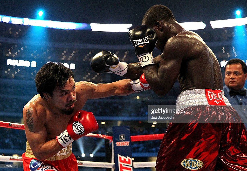 <a gi-track='captionPersonalityLinkClicked' href=/galleries/search?phrase=Manny+Pacquiao&family=editorial&specificpeople=3855506 ng-click='$event.stopPropagation()'>Manny Pacquiao</a> of the Philippines throws a left to the body of Joshua Clottey of Ghana during the WBO welterweight title fight at Cowboys Stadium on March 13, 2010 in Arlington, Texas.