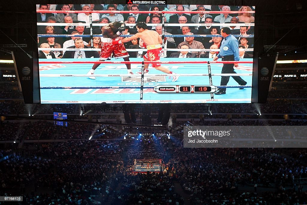 Manny Pacquiao of the Philippines throws a left to the body of Joshua Clottey of Ghana during the WBO welterweight title fight at Cowboys Stadium on March 13, 2010 in Arlington, Texas.