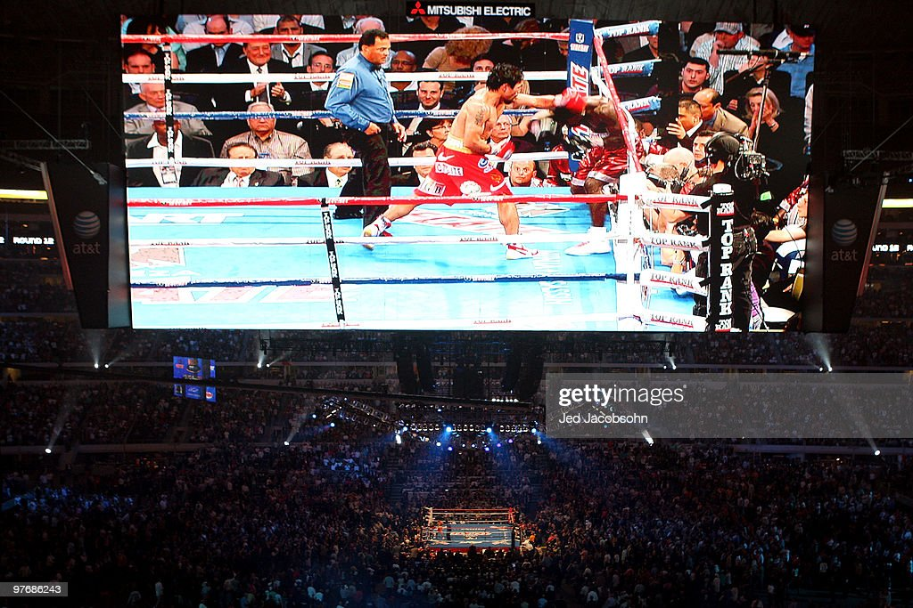 <a gi-track='captionPersonalityLinkClicked' href=/galleries/search?phrase=Manny+Pacquiao&family=editorial&specificpeople=3855506 ng-click='$event.stopPropagation()'>Manny Pacquiao</a> of the Philippines throws a left to the head of Joshua Clottey of Ghana during the WBO welterweight title fight at Cowboys Stadium on March 13, 2010 in Arlington, Texas.
