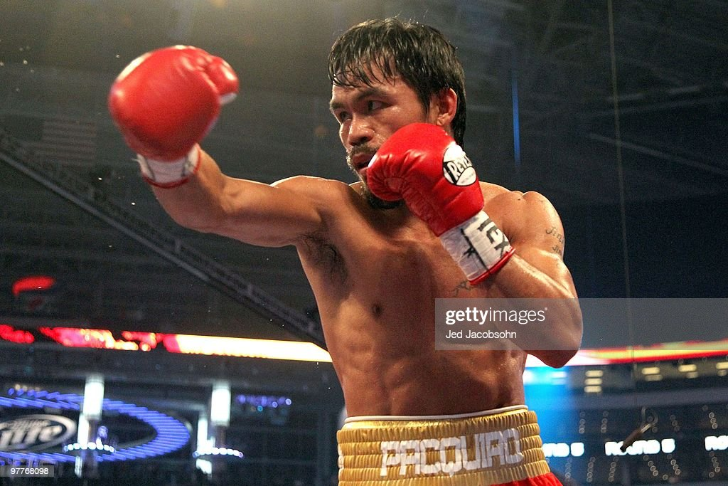 Manny Pacquiao of the Philippines throws a punch in the ring against Joshua Clottey of Ghana during the WBO welterweight title fight at Cowboys Stadium on March 13, 2010 in Arlington, Texas. Pacquiao defeated Clottey by unanimous decision.