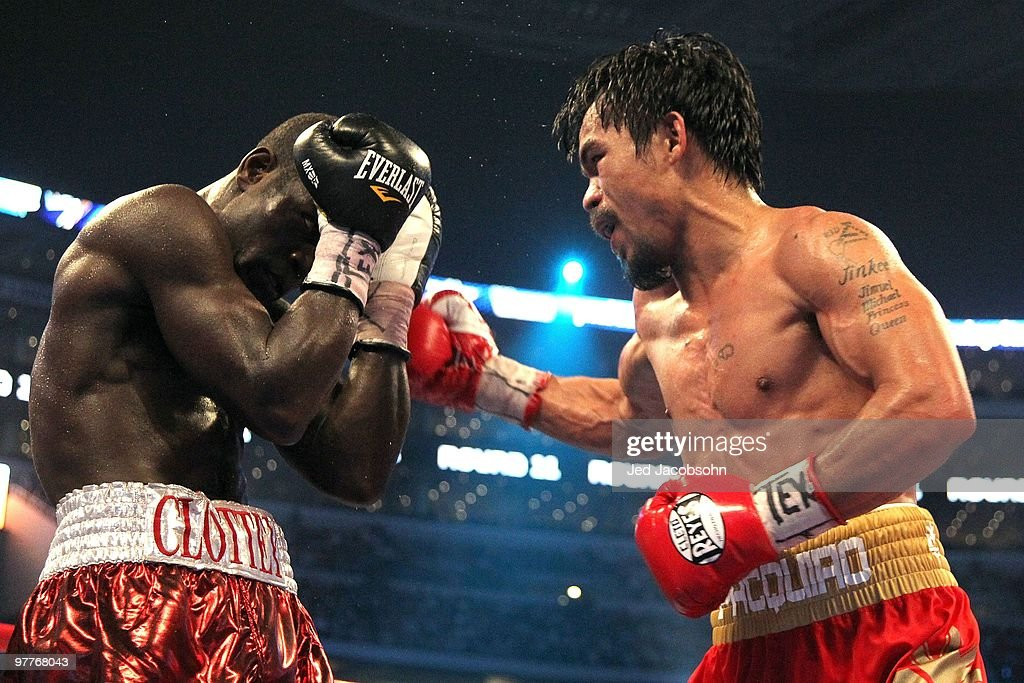 Manny Pacquiao of the Philippines throws a right to the body of Joshua Clottey of Ghana during the WBO welterweight title fight at Cowboys Stadium on...