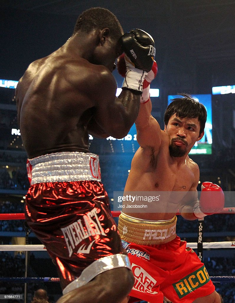 Manny Pacquiao of the Philippines throws a right to the face of Joshua Clottey of Ghana during the WBO welterweight title fight at Cowboys Stadium on March 13, 2010 in Arlington, Texas.