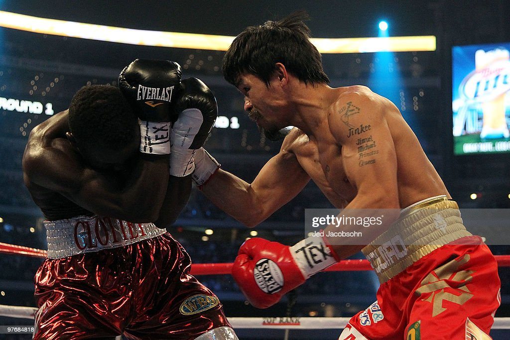 <a gi-track='captionPersonalityLinkClicked' href=/galleries/search?phrase=Manny+Pacquiao&family=editorial&specificpeople=3855506 ng-click='$event.stopPropagation()'>Manny Pacquiao</a> of the Philippines throws a right to the face of Joshua Clottey of Ghana during the WBO welterweight title fight at Cowboys Stadium on March 13, 2010 in Arlington, Texas.