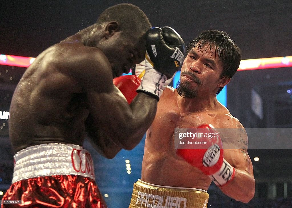 Manny Pacquiao of the Philippines throws a right to the head of Joshua Clottey of Ghana during the WBO welterweight title fight at Cowboys Stadium on...