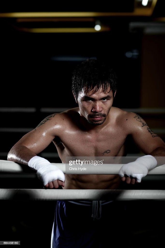 < Manny Pacquiao poses for a portrait during a training session at the Elorde boxing Gym on May 19, 2017 in Manila, Philippines.