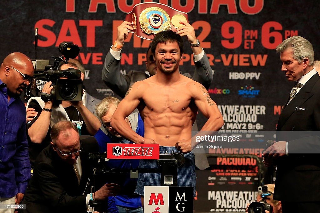 <a gi-track='captionPersonalityLinkClicked' href=/galleries/search?phrase=Manny+Pacquiao&family=editorial&specificpeople=3855506 ng-click='$event.stopPropagation()'>Manny Pacquiao</a> poses on the scale during his official weigh-in on May 1, 2015 at MGM Grand Garden Arena in Las Vegas, Nevada. Pacquiao will face Floyd Mayweather Jr. in a welterweight unification bout on May 2, 2015 in Las Vegas.