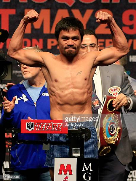 Manny Pacquiao poses on the scale during his official weighin on May 1 2015 at MGM Grand Garden Arena in Las Vegas Nevada Pacquiao will face Floyd...