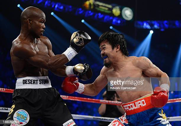 Manny Pacquiao prepares to throw a left to the head of Timothy Bradley during their WBO welterweight title fight at MGM Grand Garden Arena on June 9...