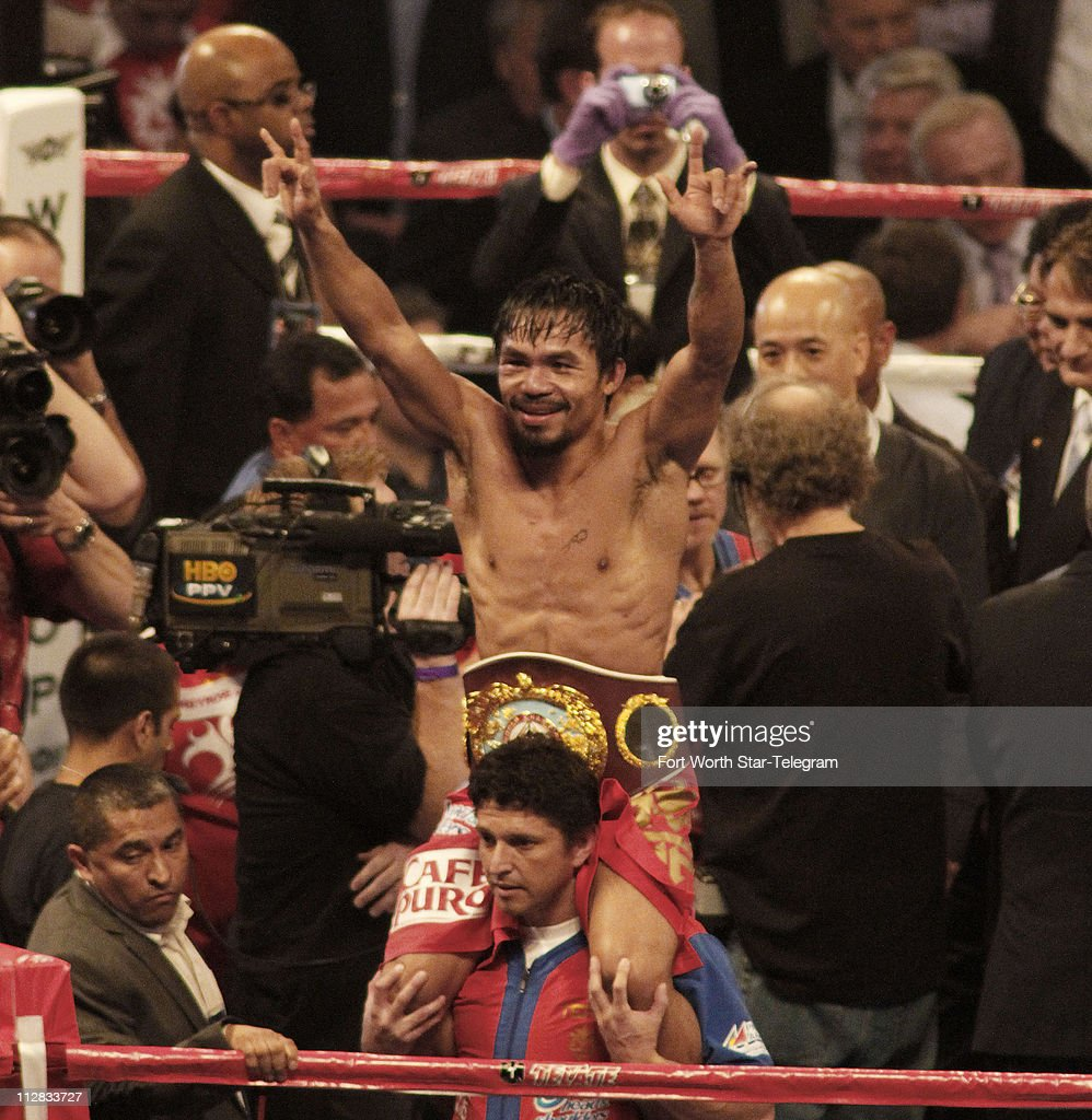 Manny Pacquiao raises his arms in victory after his fight with Joshua Clottey in the main event a 12round WBO World Welterweight title bout at...