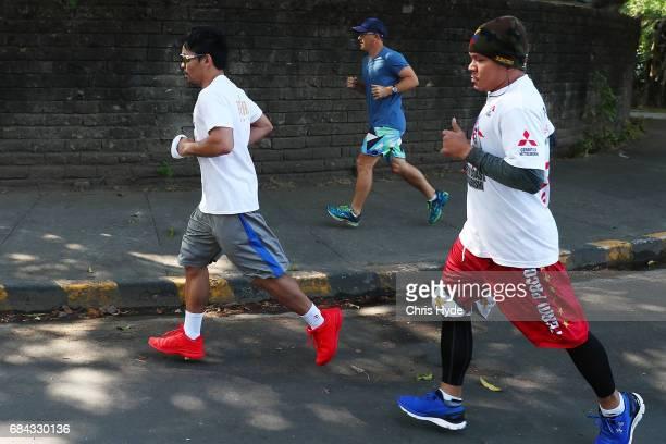 Manny Pacquiao runs around his neighborhood on May 18 2017 in Manila Philippines