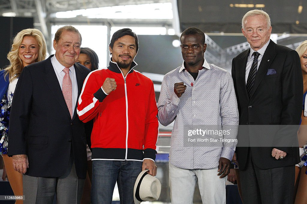 Manny Pacquiao second from left and Joshua Clottey second from right pose for photos at Cowboy Stadium in Arlington Texas Wednesday March 10 2010...