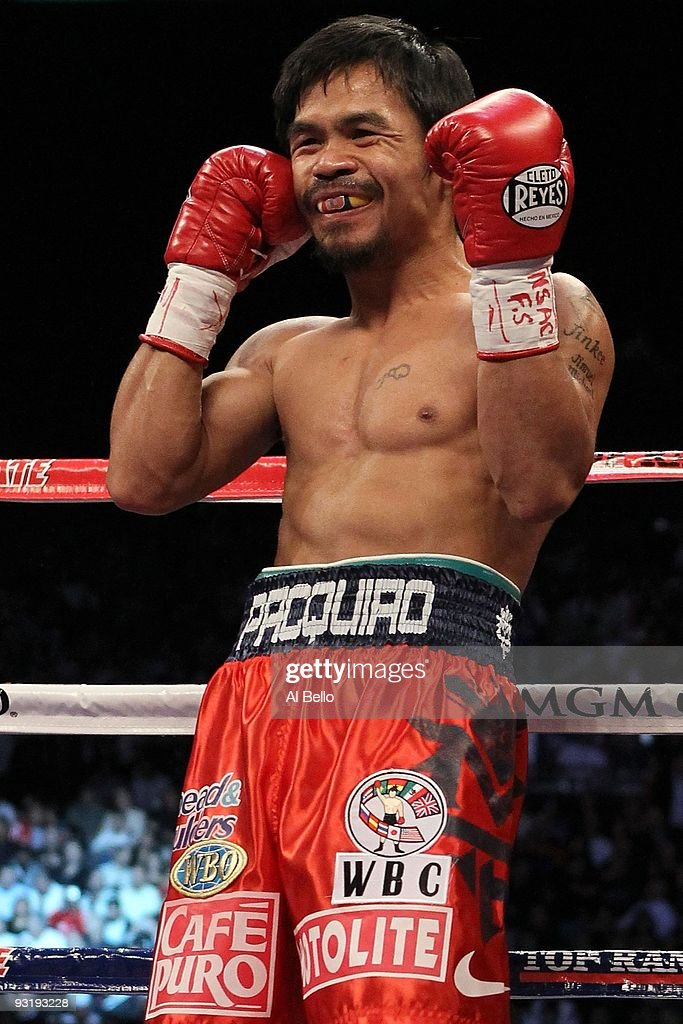 <a gi-track='captionPersonalityLinkClicked' href=/galleries/search?phrase=Manny+Pacquiao&family=editorial&specificpeople=3855506 ng-click='$event.stopPropagation()'>Manny Pacquiao</a> smiles before taking on Miguel Cotto during their WBO welterweight title fight at the MGM Grand Garden Arena on November 14, 2009 in Las Vegas, Nevada.
