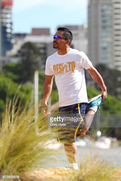 Manny Pacquiao stretches during a visit to Kangaroo Point Pacquiao is in Australia to promote his upcoming fight with Australian Jeff Horn on April...