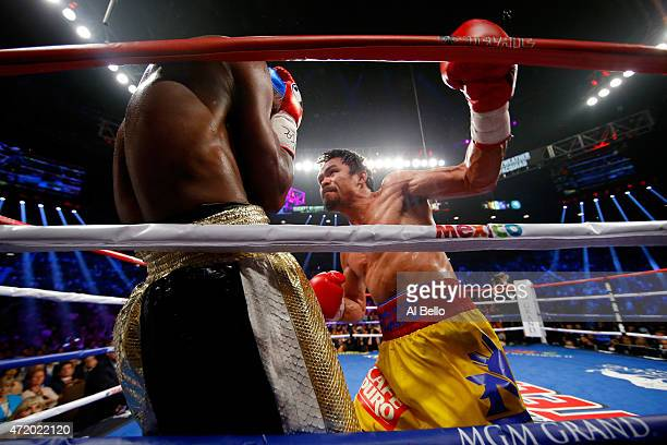 Manny Pacquiao throws a left at Floyd Mayweather Jr during their welterweight unification championship bout on May 2 2015 at MGM Grand Garden Arena...