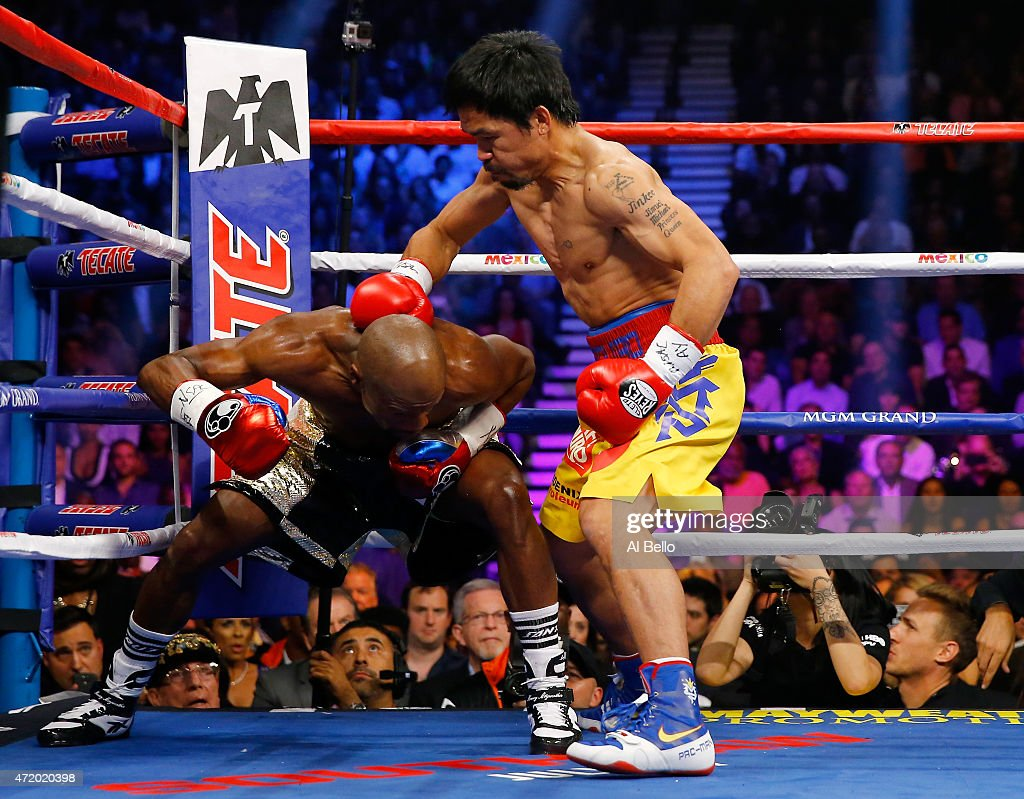 Manny Pacquiao throws a right at Floyd Mayweather Jr during their welterweight unification championship bout on May 2 2015 at MGM Grand Garden Arena...