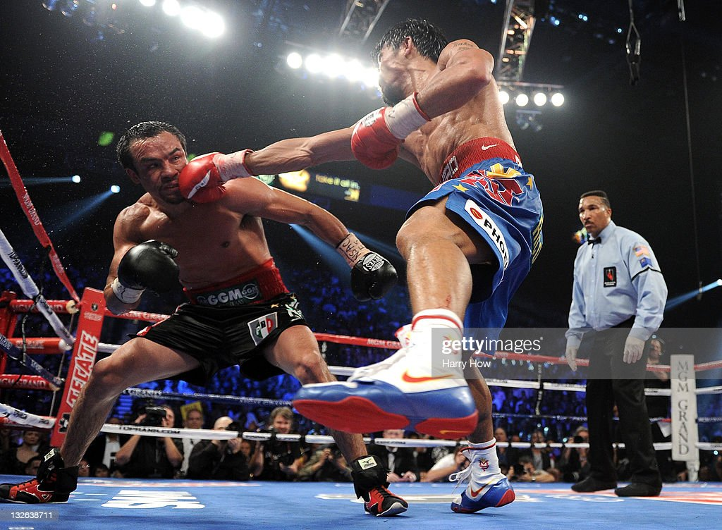 <a gi-track='captionPersonalityLinkClicked' href=/galleries/search?phrase=Manny+Pacquiao&family=editorial&specificpeople=3855506 ng-click='$event.stopPropagation()'>Manny Pacquiao</a> throws a right to the head of <a gi-track='captionPersonalityLinkClicked' href=/galleries/search?phrase=Juan+Manuel+Marquez&family=editorial&specificpeople=4202669 ng-click='$event.stopPropagation()'>Juan Manuel Marquez</a> during the WBO world welterweight title fight at the MGM Grand Garden Arena on November 12, 2011 in Las Vegas, Nevada.