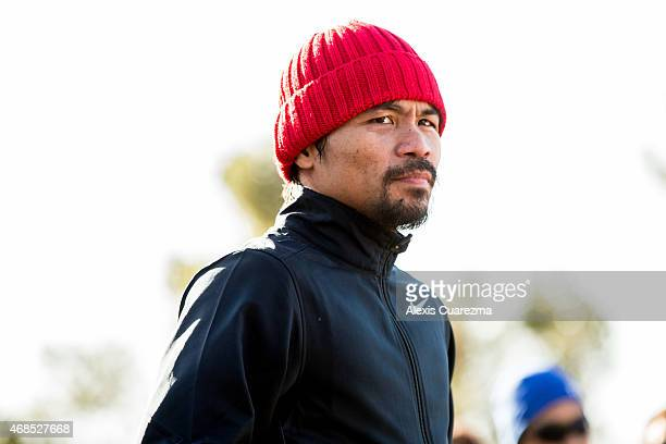 Manny Pacquiao trains with his team at Griffith Park on April 3 2015 in Los Angeles California Pacquiao is training for his upcoming mega fight with...