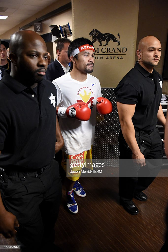 <a gi-track='captionPersonalityLinkClicked' href=/galleries/search?phrase=Manny+Pacquiao&family=editorial&specificpeople=3855506 ng-click='$event.stopPropagation()'>Manny Pacquiao</a> walks backstage at 'Mayweather VS Pacquiao' at MGM Grand Garden Arena on May 2, 2015 in Las Vegas, Nevada.