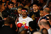 Manny Pacquiao walks to the ring with Jimmy Kimmel before his welterweight unification championship bout against Floyd Mayweather Jr on May 2 2015 at...