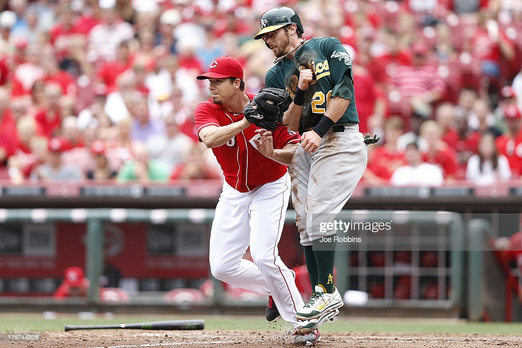 <a gi-track='captionPersonalityLinkClicked' href=/galleries/search?phrase=Manny+Parra&family=editorial&specificpeople=4175286 ng-click='$event.stopPropagation()'>Manny Parra</a> #43 of the Cincinnati Reds tags out <a gi-track='captionPersonalityLinkClicked' href=/galleries/search?phrase=Eric+Sogard&family=editorial&specificpeople=6796459 ng-click='$event.stopPropagation()'>Eric Sogard</a> #28 of the Oakland Athletics after he was caught between third base and home plate during the game at Great American Ball Park on August 7, 2013 in Cincinnati, Ohio. The Reds won 6-5.