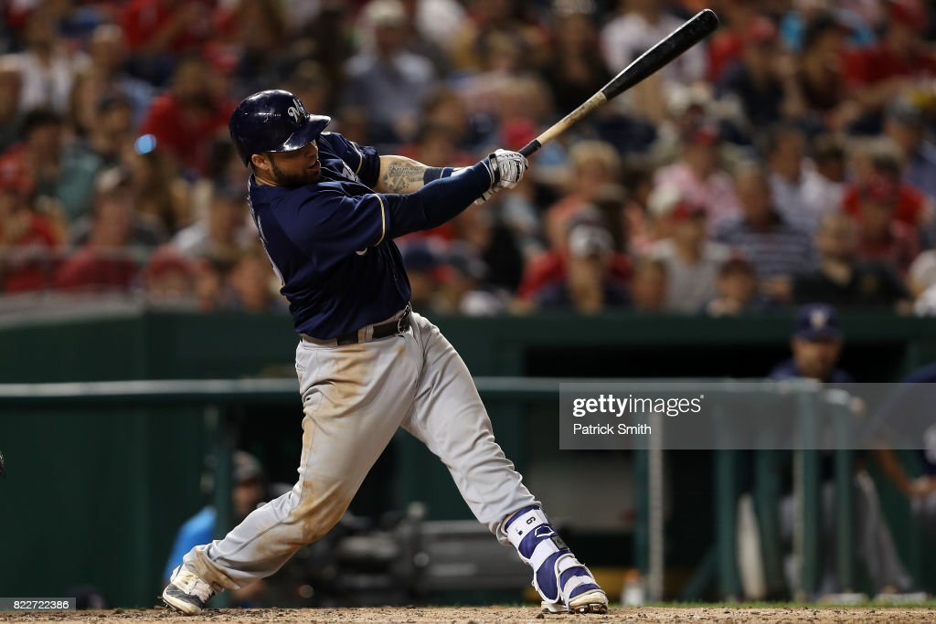Manny Pina #9 of the Milwaukee Brewers hits a home run against the Washington Nationals during the fifth inning at Nationals Park on July 25, 2017 in Washington, DC.