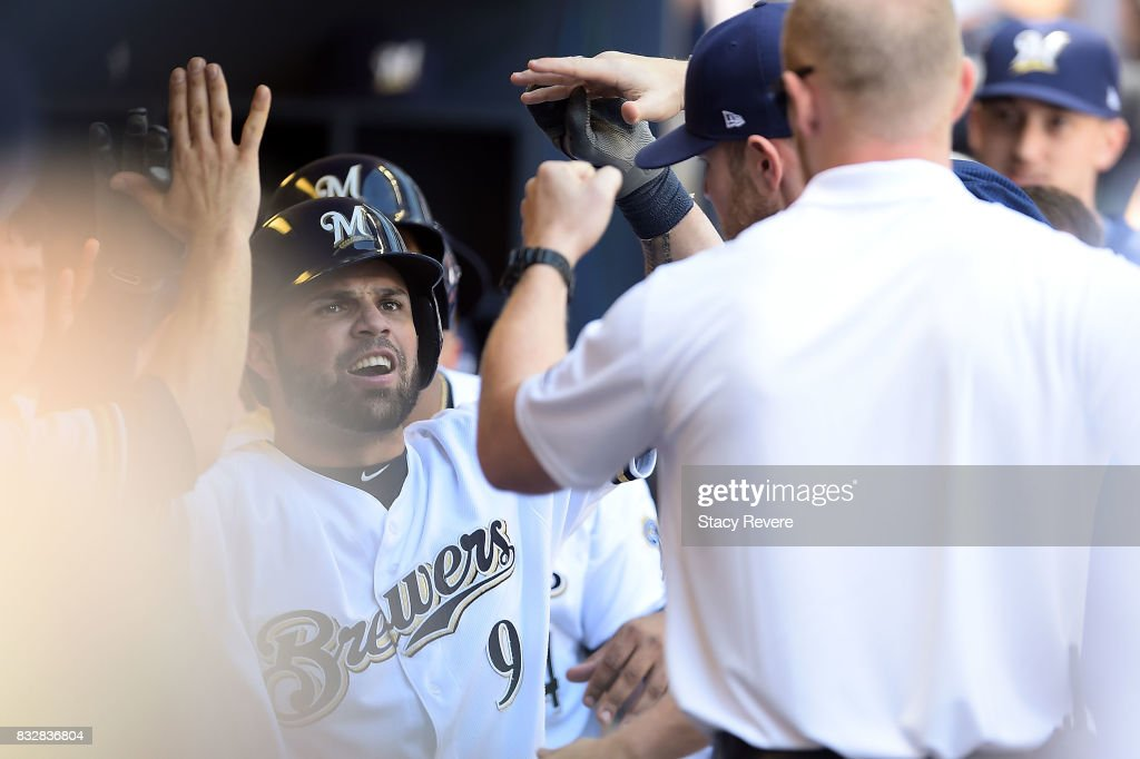 Manny Pina #9 of the Milwaukee Brewers is congratulated by teammates following a two run home run during the eighth inning of a game against the Pittsburgh Pirates at Miller Park on August 16, 2017 in Milwaukee, Wisconsin.
