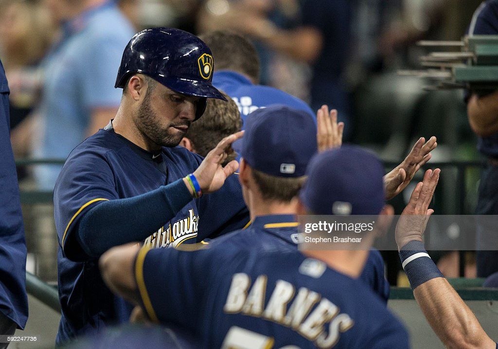 Manny Pina #9 of the Milwaukee Brewers is congratulated by teammates after scoring on a hit by Ryan Braun #8 of the Milwaukee Brewers during the ninth inning of a game against the Seattle Mariners at Safeco Field on August 19, 2016 in Seattle, Washington. The Mariners won the game 7-6.