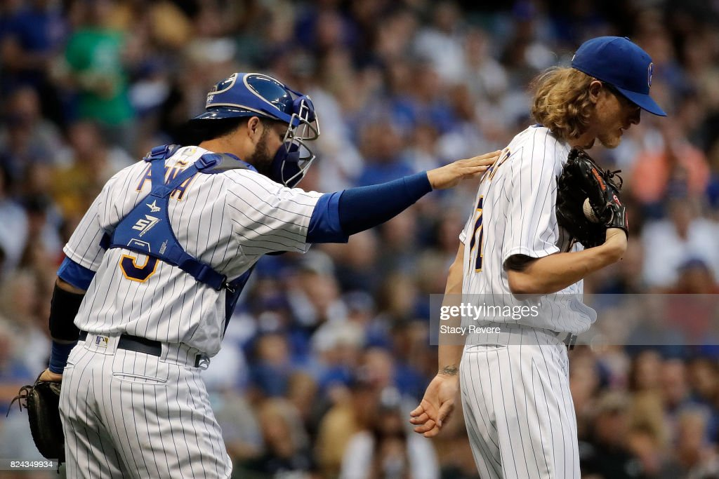 Manny Pina #9 of the Milwaukee Brewers speaks with Josh Hader #71 during the sixth inning of a game against the Chicago Cubs at Miller Park on July 29, 2017 in Milwaukee, Wisconsin.