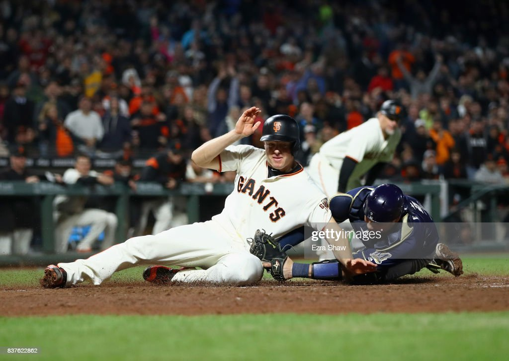 Manny Pina #9 of the Milwaukee Brewers tags out Nick Hundley #5 of the San Francisco Giants at home plate in the eighth inning at AT&T Park on August 22, 2017 in San Francisco, California.