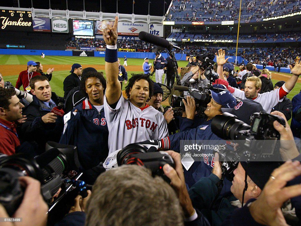 Manny Ramirez and Pedro Martinez of the Boston Red Sox celebrate after defeating the New York Yankees 103 to win game seven of the American League...