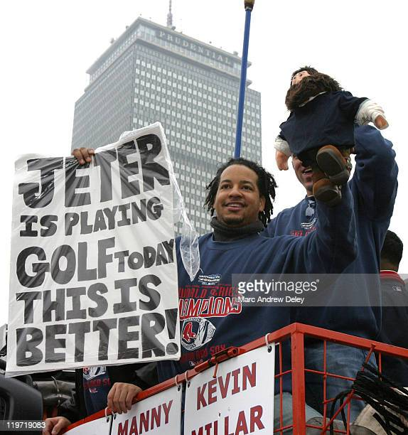 Manny Ramirez holds up a sign during the Rolling Rally parade held in honor of the Red Sox World Series victory in Boston Massachusetts on October 30...